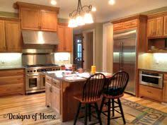Kitchen Cherry Cabinets Transitional Kitchen Natural Cherry Wood Cabinets With A Black