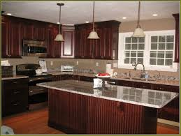 what color granite looks best with cherry cabinets image result for cherry kitchen cabinets cherry kitchen