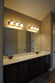 lighting in bathroom ideas double handle fucet on side bathtub lighting in bathroom ideas double handle fucet on side bathtub brown wooden vanity top black fur rug mirror pendant lamps ceiling concrete wall