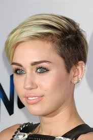 miley cyrus hairstyle name miley cyrus straight golden blonde side part two tone undercut