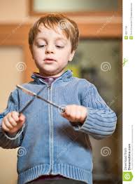 little boy paying with knives stock photo image 43611784