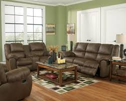 Loveseats That Rock And Recline Benchcraft Quarterback Canyon Rocker Recliner In Brown Faux