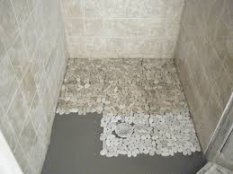 river rock flooring bathroom black stone pebble wall ornament