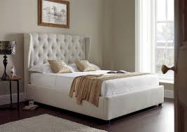 ottoman beds with mattress symphony upholstered winged ottoman storage bed natural storage