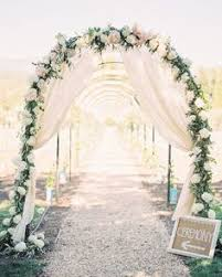 wedding arches to make an arch decorating the entrance to a church flowers and stuff