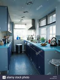 modern galley kitchen photos rubber flooring in modern galley kitchen with pale blue worktops