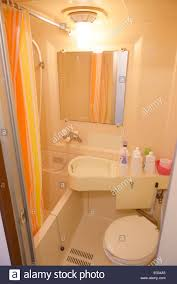 tiny japanese apartment tiny bathroom with plastic walls of a tokyo apartment japan stock