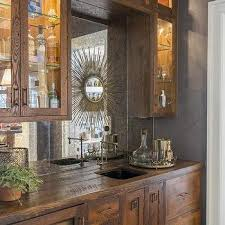 distressed wood bar cabinet over the bar mirror design ideas