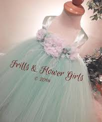 mint green flower dress with white flowers and feathers