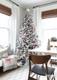 fun festive and flocked christmas tree inspired by charm