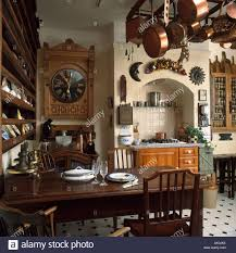 large wall clock and copper pans on rack in traditional kitchen