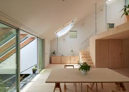 tomohiro hata sets hillside house in kobe beneath sloping roof