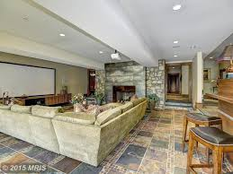 home theater with stone fireplace u0026 sunken living room in potomac