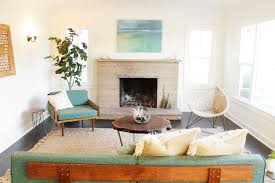 Midcentury Modern Living Room - eclectic living room with wall sconce by platform home staging