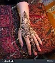 beautiful henna tattoo design on women stock photo 604038818