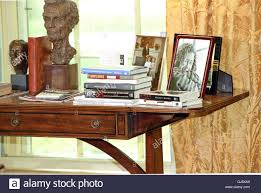 Desk In Oval Office by Books And Photos On The Credenza Behind The Desk As United States