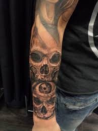 forearm black and grey skulls chronic ink