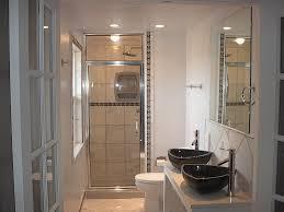 bathroom artistic cream ceramics tiles bathroom wall combined unique black vessel sinks on white bathroom vanity combined with glass door bathroom shower and
