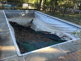 an easy cost effective way to fill in your old swimming pool