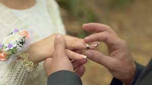ring marriage finger putting wedding ring on groom s finger at