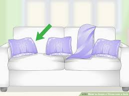 3 ways to drape a throw over a sofa wikihow