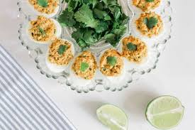 deviled egg dish avocado deviled eggs recipe the ideal keto snack dr axe