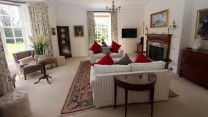stately holiday home for let near aberdeen scotland the drawing room with overstuffed seating invites long lazy evenings