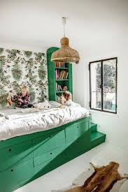 Small Bedroom With No Wall Space Green Kids Bedroom With Raised Bed And Storage Underneath Kids