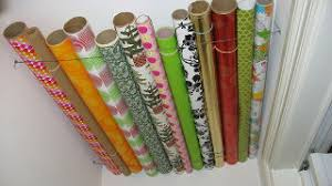 hang wrapping paper rolls in a closet ceiling
