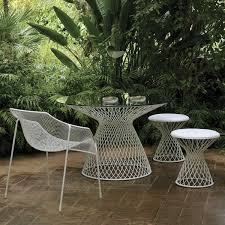 emu metal mesh glass outdoor dining table by home infatuation