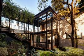 forest house this forest house consists of two volumes connected by metal bridges