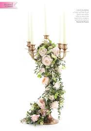 wedding flowers and accessories magazine gold candelabra centrepieces balloons with trailing foliage