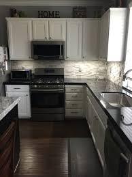 black backsplash in kitchen kitchen black granite with a gray stone backsplash for the home