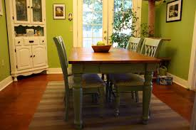 green wall dining room with awesome farmhouse table for rustic