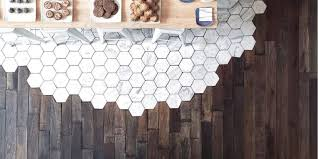 hexagonal tiles and hardwood make the most beautiful flooring