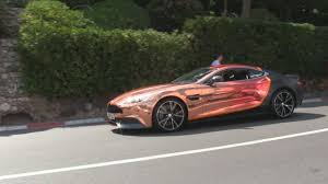 aston martin blacked out aston martin vanquish w crazy chrome orange and matte black wrap