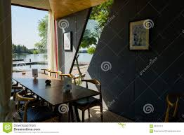 table and chairs in waterside container made coffeebar stock photo