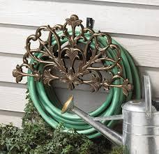 filigree decorative garden hose holder hanger mounted rack reel