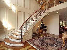 traditional staircase with hardwood floors u0026 high ceiling in