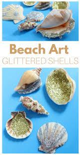 beach art project glittered shells beach art shell and beach