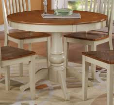 round dining table with leaf cream granite countertop cream color