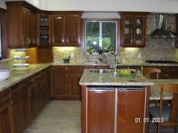 fancy white marble countertop also mahogany cabinets set as well