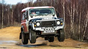 land rover ninety going racing in a land rover defender