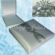 snowflake wedding invitations blue wedding invitation box with snowflake brooch handbag