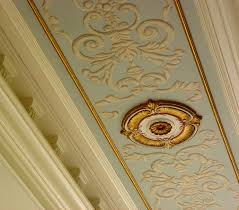 grissaille painting of neo classic motif on dining room ceiling