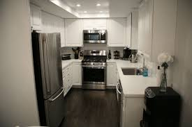 Light Grey Walls White Trim first home renovation white quartz countertops wall wood and