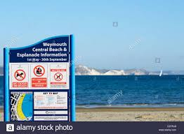 Dorset England Map by Public Information Board With Beach Sea And Cliffs In Background
