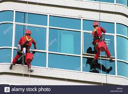 risky life window cleaners in action hanging on a u0027bosun u0027s