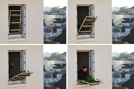 thinking outside the window box urban garden system suspends from