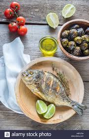 dorade cuisine grilled dorade royale fish with fresh and baked vegetables stock